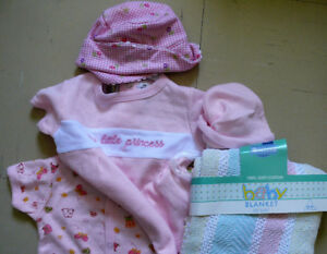 Cotton blanket and clothes for a baby girl