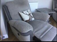 Grey reclining arm chair