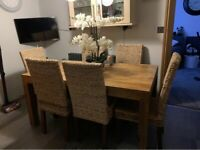 Solid oak table and 6 wickers