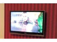 37inch SHARP AQUOS LCD TV and Toshiba DVD player.