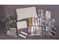 Wii console, balance board, controls and 20 games