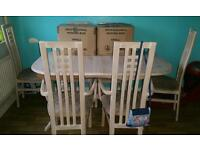 6-8 seater table and 6 chairs