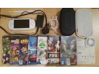 Sony PSP 1003 White with 8 games, charger, memory card, 2 cases, headphones- Good Condition