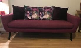 Almost new plum coloured couch
