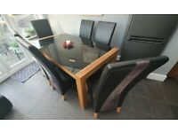 Glass top oak effect dining table and six chairs. FREE delivery in Derby
