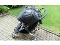 Double Pushchair. Baby Jogger City Mini