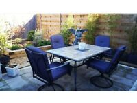 Large garden table tiled top, with 4 padded swivel chairs excellent condition
