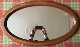 Large oval wooden framed mirror