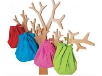 Amazing wall storage, off the floor tree with 5 bags for toys