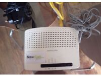 Modem / Wireless Router By Technicolor TG582n PRO with power adapter, ethernet and phone cable.