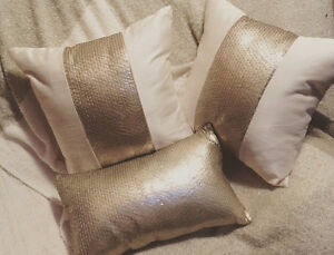 Beautiful silk sequin off white/gold pillows used for staging