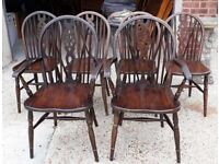 Set Of Six Vintage Oak And Elm Wheel-back Dining Chairs Including Two Carvers