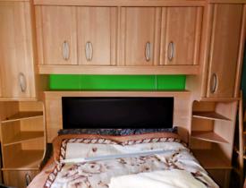 Oak Bedroom furniture set above the bed