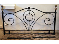 Black metal double bed headboard.