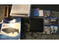 Playstation 4 in box with 5 games