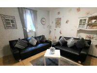 DFS stylish black leather 3 seater and 2 seater sofas very stylish modern design solid steel feet
