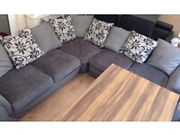 Large corner grey fabric/leather look sofa only used a few months