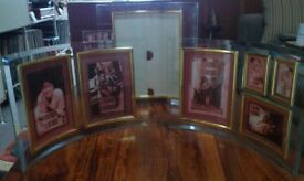 Three Curved Glass Photo frames with bevelled edge and brass trim