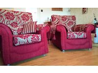 Red & taupe fabric three piece suite with matching cushions; 18 months old & in excellent condition.