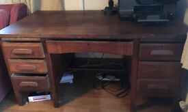 Lovely dark wood desk with huge drawers
