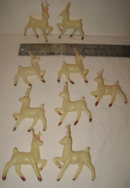 9 Tiny Celluloid Christmas Reindeer Santa Sleigh or Package Ties Ornaments