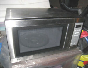 GE Stainless Steel Microwave 1.1 cub.ft 1500-Watt, used great co