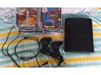PS3 500gb Super Slim with 23 games, 2 controllers with charging lead