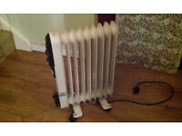 2 KW Oil filled electric heater x 2 (£20 each)