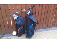 two sets of kids slazenger golf clubs with bags and balls