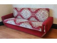Storage, bed, red patterned fabric upholstered settee.