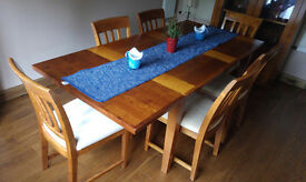 M&S wood extendable dining table with six matching chairs