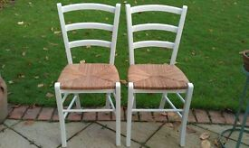TWO WOODEN LADDER BACK CHAIRS WITH RUSH SEATS JUST REFURBISHED