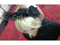 Ladies new black fascinator design on a head band.