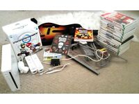 Wii + Games + Guitar + Mario Kart Steering Wheel + 2 Remotes and Nunchuck