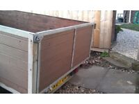twin axle wood trailer with a frame