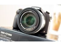 AS NEW hardly used Panasonic FZ1000 super zoom digital camera with box & accessories (like DSLR)