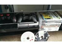 PS3 with 2 wireless controllers and 10 games