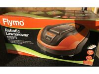 Flymo 1200R Robotic Cordless Lawnmower. Never used still in Box.