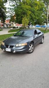 2004 Pontiac Bonneville Sedan with trailer hitch and trailer
