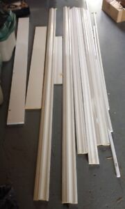 11 white pieces of VARIOUS TYPES OF TRIM.