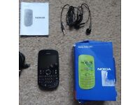 nokia 201 on o2 and tesco with box and charger