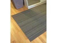 Grey low pile rug