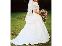 Stunning Ronald Joyce ivory silk wedding dress, size 14. £250 , buyer to collect.