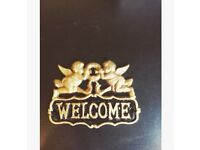 Gold Welcome sign