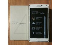 Galaxy Note 4 unlocked white 32GB + wireless charger, boxed like new