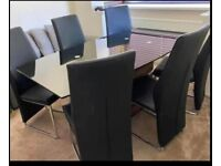 Leeks glass topped, Wood base dinning table with 6 leather chairs