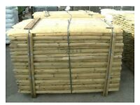 Wooden round fence posts