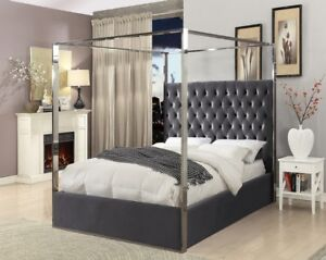 GREY VELVET BED WITH CHROME TOP  AND AN UPHOLSTERED FACE WITH BU