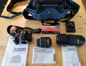 Nikon D3200 DSLR camera with two lens, camera bag and tripod