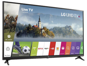 LG UHD TV 55 INCH SMART TV NEW CONDITION WITH A TV STAND / MOUNT